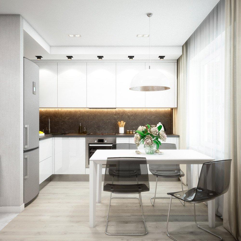 Белые шкафы в интерьере угловой кухни